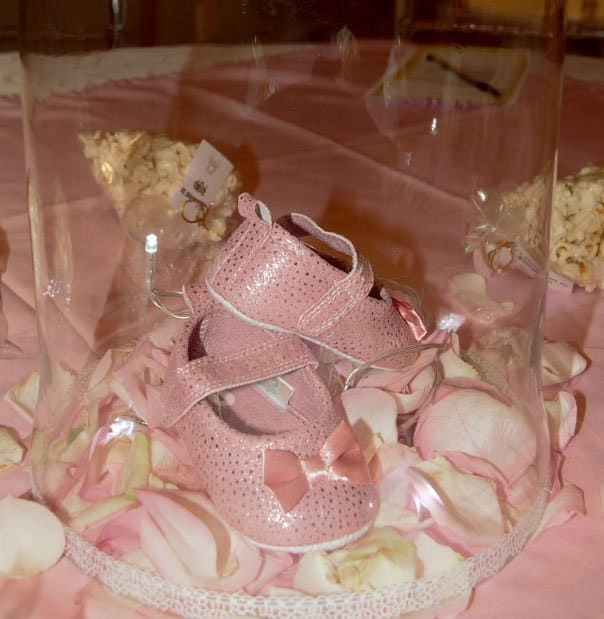 pink shoes in glass contianer